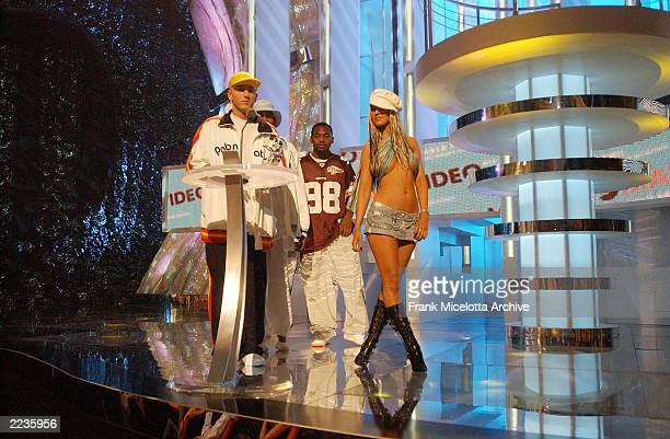 Christina Aguilera presents Best Video of the Year Award to Eminem on the 2002 MTV Video Music Awards at Radio City Music Hall in New York City...