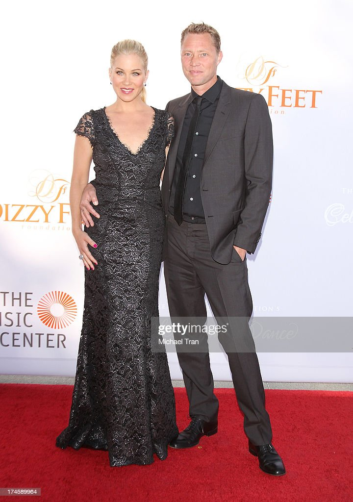 Christina Applegate (L) and Martyn LeNoble arrive at the Dizzy Feet Foundation's 3rd Annual Celebration of Dance Gala held at Dorothy Chandler Pavilion on July 27, 2013 in Los Angeles, California.