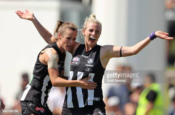 Christina Bernardi of the Magpies is congratulated by her teammates after kicking a goal during the round six AFL Women's match between the...