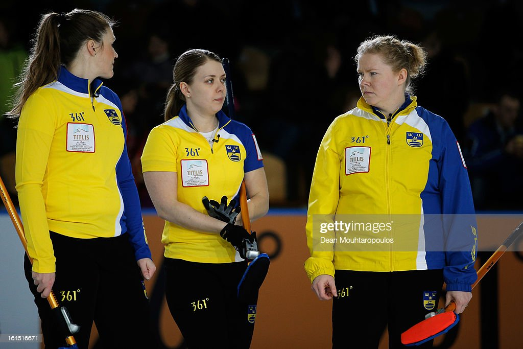 Christina Bertrup, Maria Wennerstrom and Margaretha Sigfridsson of Sweden screams instructions to team mates during the Gold medal match between Sweden and Scotland on Day 9 of the Titlis Glacier Mountain World Women's Curling Championship at the Volvo Sports Centre on March 24, 2013 in Riga, Latvia.