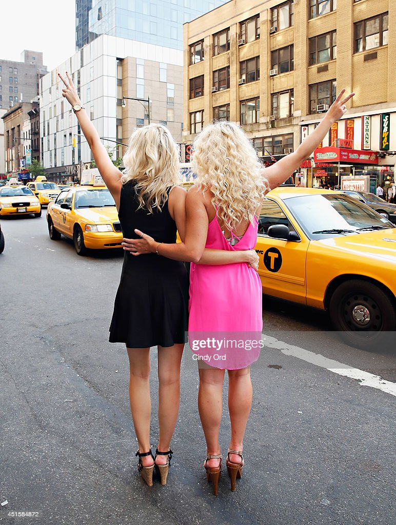 Christina Boesler and Elizabeth Wilson take part in Row NYC's 'The Paparazzi Project' at Row NYC on July 1, 2014 in New York City.
