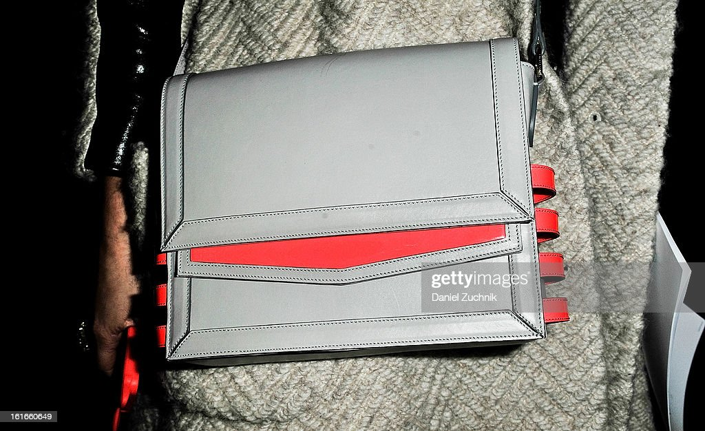 Christina Boliva, works in PR, seen outside the Marchesa show wearing a Louboutin bag on February 13, 2013 in New York City.