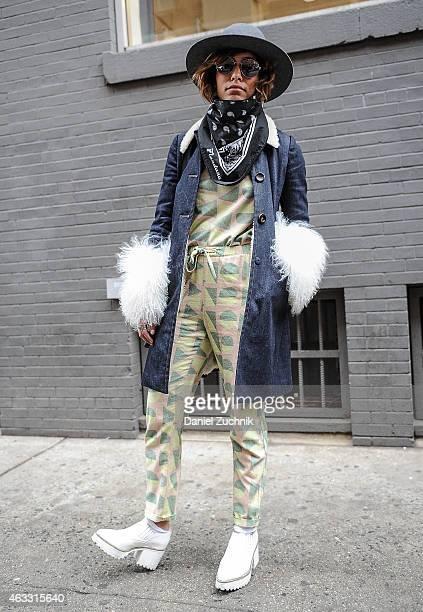 Christina Caradona is seen outside the Marissa Webb show wearing a Miu Miu coat and Samuji top and pants on February 12 2015 in New York City
