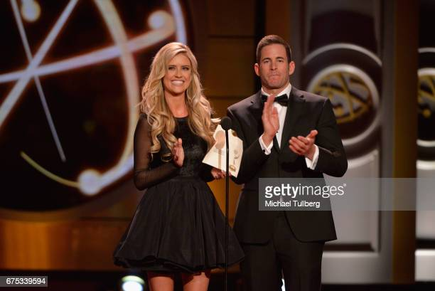 Christina El Moussa and Tarek El Moussa present the award for outstanding entertainment news program at the 44th annual Daytime Emmy Awards at...