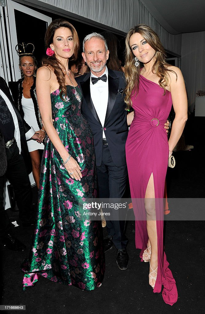 (L to R) Christina Estrada Juffali, Patrick Cox and Elizabeth Hurley attend the 15th Annual White Tie and Tiara Ball to Benefit Elton John AIDS Foundation in Association with Chopard at Woodside on June 27, 2013 in Windsor, England. No sales to online/digital media worldwide until the 14th of July. No sales before July 14th, 2013 in UK, Spain, Switzerland, Mexico, Dubai, Russia, Serbia, Bulgaria, Turkey, Argentina, Chile, Peru, Ecuador, Colombia, Venezuela, Puerto Rico, Dominican Republic, Greece, Canada, Thailand, Indonesia, Morocco, Malaysia, India, Pakistan, Nigeria. All pictures are for editorial use only and mention of 'Chopard' and 'The Elton John Aids Foundation' are compulsory. No sales ever to Ok, Now, Closer, Reveal, Heat, Look or Grazia magazines in the United Kingdom. No sales ever to any jewellers or watchmakers other than Chopard