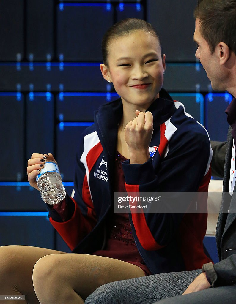 <a gi-track='captionPersonalityLinkClicked' href=/galleries/search?phrase=Christina+Gao&family=editorial&specificpeople=6719493 ng-click='$event.stopPropagation()'>Christina Gao</a> of the United States pumps her fist as she reacts to her score during the ladies short program at the ISU GP 2013 Skate Canada International at Harbour Station on October 25, 2013 in Saint John, New Brunswick, Canada.