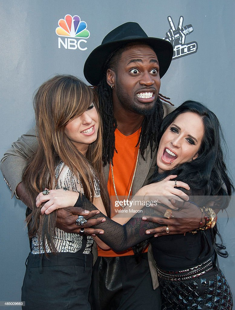 <a gi-track='captionPersonalityLinkClicked' href=/galleries/search?phrase=Christina+Grimmie&family=editorial&specificpeople=7293581 ng-click='$event.stopPropagation()'>Christina Grimmie</a>, <a gi-track='captionPersonalityLinkClicked' href=/galleries/search?phrase=Delvin+Choice&family=editorial&specificpeople=12505219 ng-click='$event.stopPropagation()'>Delvin Choice</a> and <a gi-track='captionPersonalityLinkClicked' href=/galleries/search?phrase=Kat+Perkins&family=editorial&specificpeople=12537553 ng-click='$event.stopPropagation()'>Kat Perkins</a> arrive at NBC's 'The Voice' Season 6 Top 12 Red Carpet Event at Universal CityWalk on April 15, 2014 in Universal City, California.