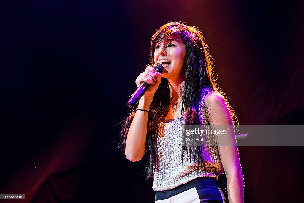 <a gi-track='captionPersonalityLinkClicked' href=/galleries/search?phrase=Christina+Grimmie&family=editorial&specificpeople=7293581 ng-click='$event.stopPropagation()'>Christina Grimmie</a> performs live at Key Arena on November 12, 2013 in Seattle, Washington.