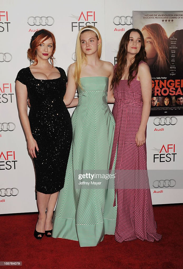 Christina Hendricks, Elle Fanning, and Alice Englert arrive at the 'Ginger And Rosa' special screening during AFI Fest 2012 at Grauman's Chinese Theatre on November 7, 2012 in Hollywood, California.