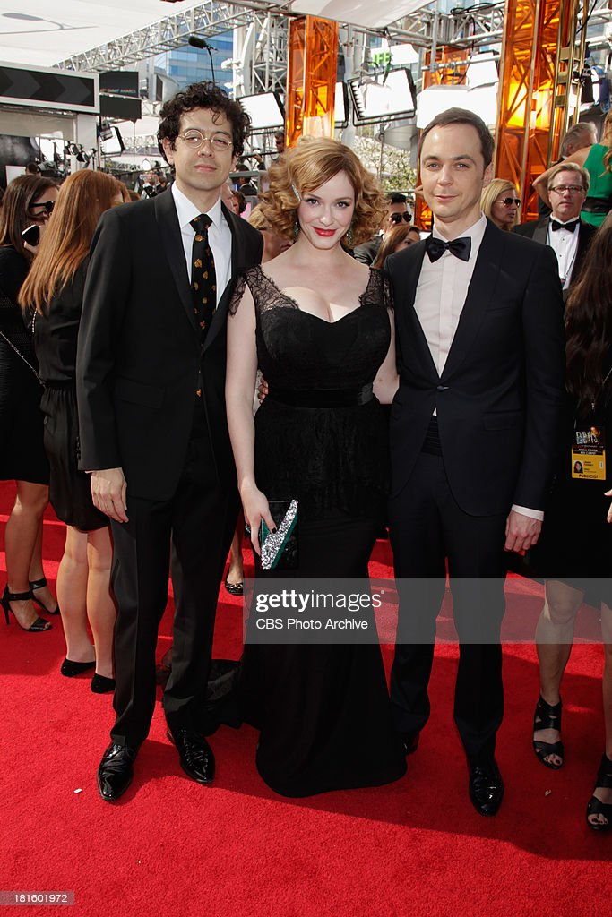Christina Hendricks of Mad Men with husband Geoffrey Arend and Jim Parsons of The Big Bang Theory on the red carpet for the 65th Primetime Emmy...