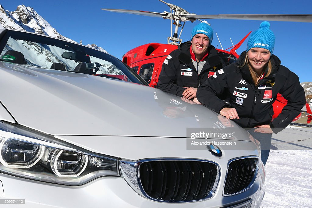Christina Hengster poses with Benjamin Maier during the BMW Snow Driving Experience prior to the IBSF World Championship 2016 on February 11, 2016 in Soelden, Austria.