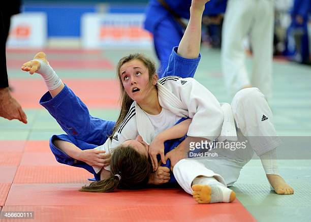 Christina Kelsall of Tonbridge JC holds Skye Sands of Murakwai JC for ippon in the early u48kg pool contests at the British Junior Judo Championships...