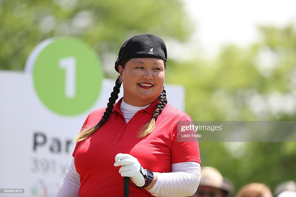 <a gi-track='captionPersonalityLinkClicked' href=/galleries/search?phrase=Christina+Kim&family=editorial&specificpeople=572750 ng-click='$event.stopPropagation()'>Christina Kim</a> from the United States gets ready to start the final round of the LPGA Volvik Championship on May 29, 2016 at Travis Pointe Country Club in Ann Arbor, Michigan.