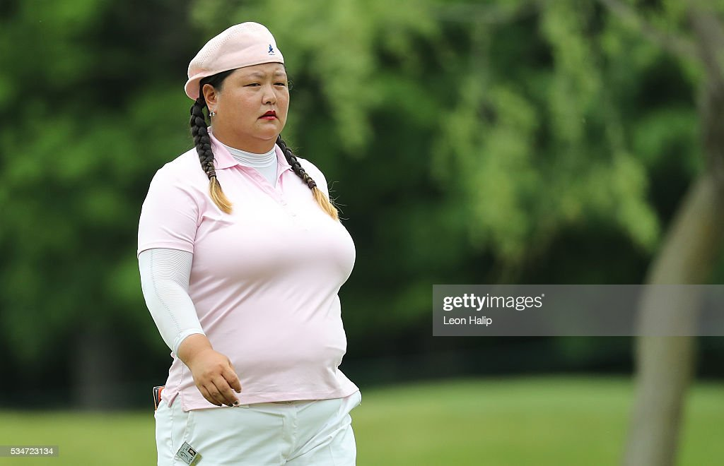 Christina Kim from the United States walks to the fifth green during the second round of the LPGA Volvik Championship on May 27, 2016 at Travis Pointe Country Club Ann Arbor, Michigan.