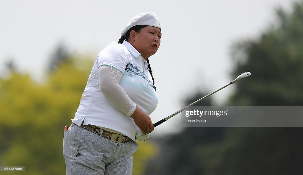 <a gi-track='captionPersonalityLinkClicked' href=/galleries/search?phrase=Christina+Kim&family=editorial&specificpeople=572750 ng-click='$event.stopPropagation()'>Christina Kim</a> hits her approach shot to the ninth green during the first round of the LPGA Volvik Championships on May 26, 2016 at Travis Pointe Country Club Ann Arbor, Michigan.