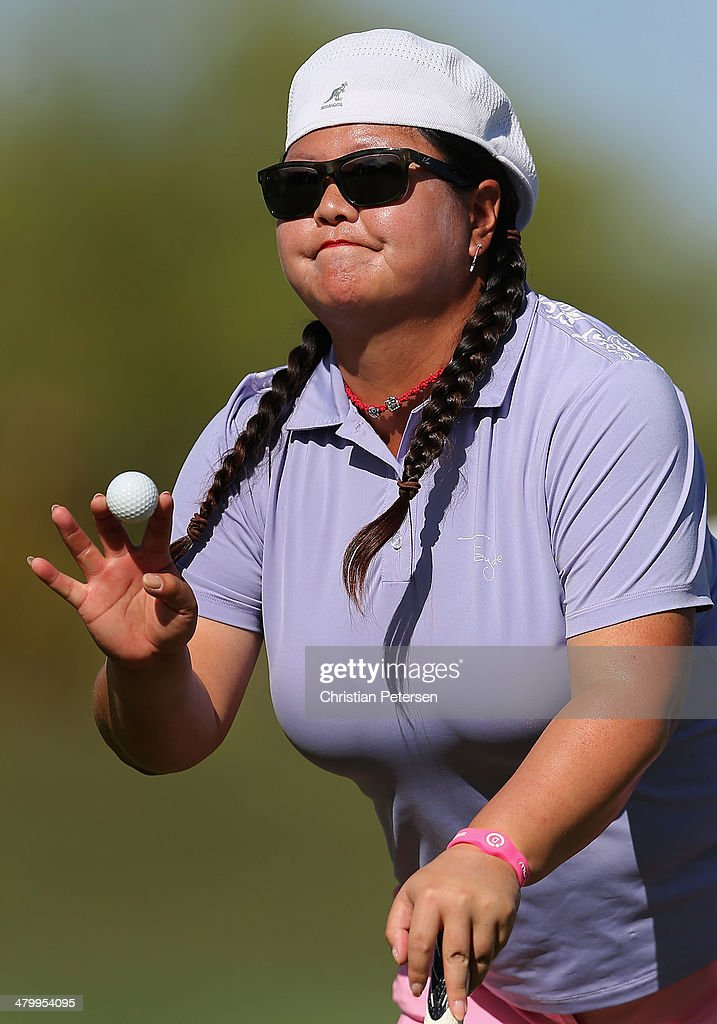Christina Kim reacts to fans after putting on the ninth green during the second round of the JTBC LPGA Founders Cup at Wildfire Golf Club on March 21, 2014 in Phoenix, Arizona.
