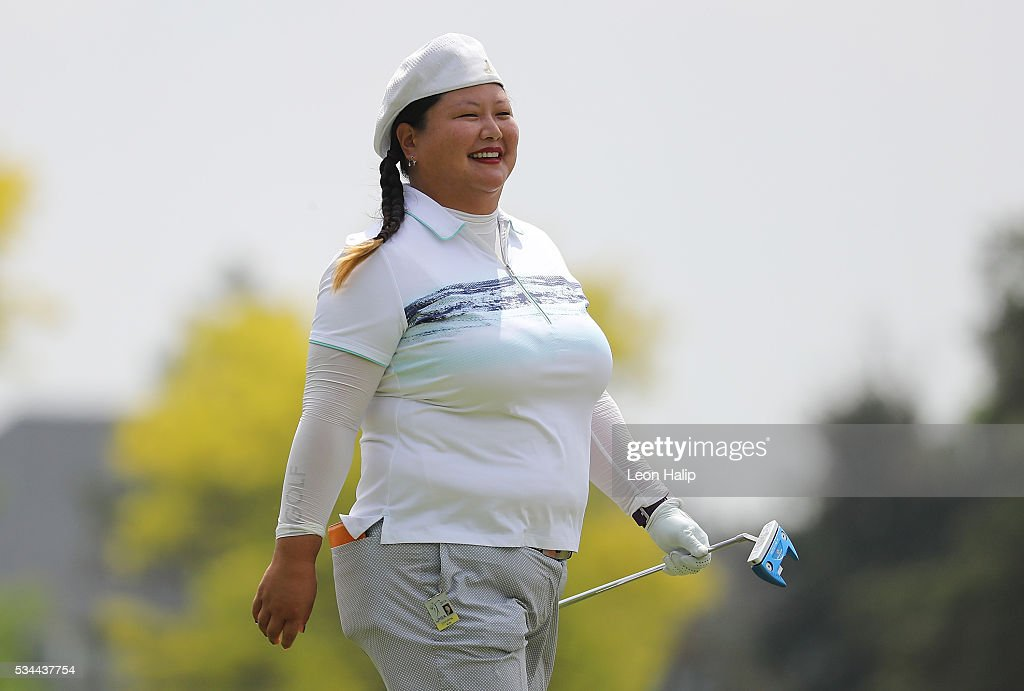 <a gi-track='captionPersonalityLinkClicked' href=/galleries/search?phrase=Christina+Kim&family=editorial&specificpeople=572750 ng-click='$event.stopPropagation()'>Christina Kim</a> walks to the ninth green during the first round of the LPGA Volvik Championships on May 26, 2016 at Travis Pointe Country Club Ann Arbor, Michigan.