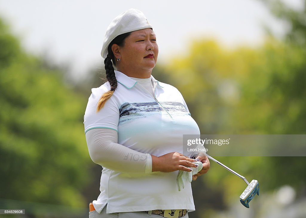 <a gi-track='captionPersonalityLinkClicked' href=/galleries/search?phrase=Christina+Kim&family=editorial&specificpeople=572750 ng-click='$event.stopPropagation()'>Christina Kim</a> walks to the ninth green during the first round of the LPGA Volvik Championship on May 26, 2016 at Travis Pointe Country Club Ann Arbor, Michigan.