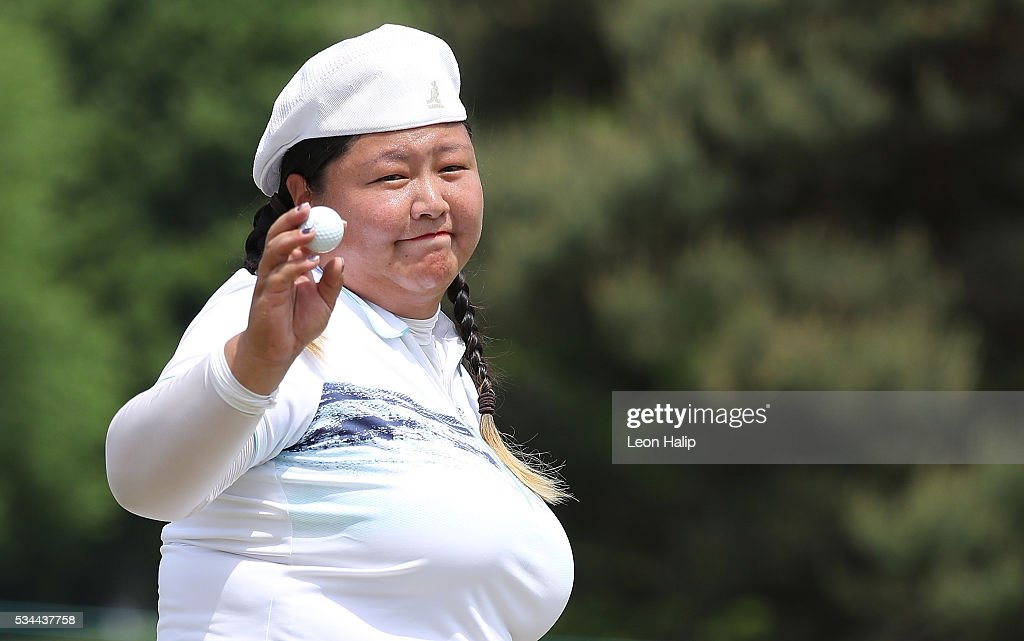 <a gi-track='captionPersonalityLinkClicked' href=/galleries/search?phrase=Christina+Kim&family=editorial&specificpeople=572750 ng-click='$event.stopPropagation()'>Christina Kim</a> waves to the fans on the ninth green during the first round of the LPGA Volvik Championships on May 26, 2016 at Travis Pointe Country Club Ann Arbor, Michigan.