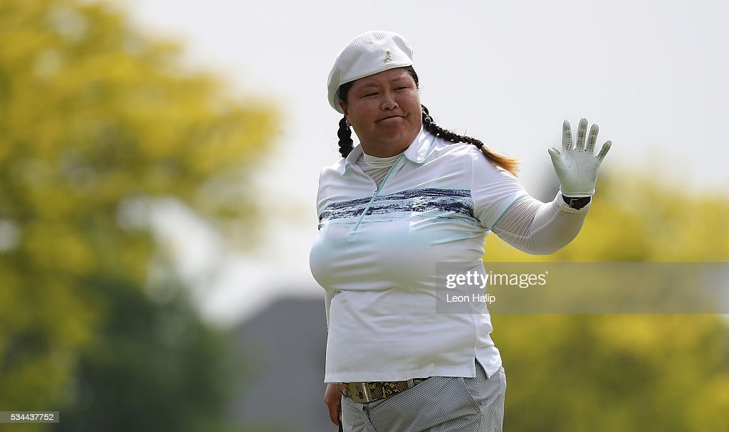 <a gi-track='captionPersonalityLinkClicked' href=/galleries/search?phrase=Christina+Kim&family=editorial&specificpeople=572750 ng-click='$event.stopPropagation()'>Christina Kim</a> waves to the fans on the ninth hole during the first round of the LPGA Volvik Championships on May 26, 2016 at Travis Pointe Country Club Ann Arbor, Michigan.