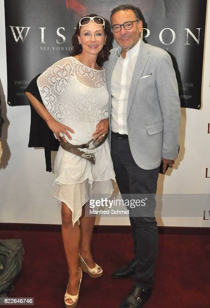 Christina Lugner and Heinz Stiastny pose during the 'Wish Upon' premiere in Vienna at Lugner Lounge Kino on July 25 2017 in Vienna Austria