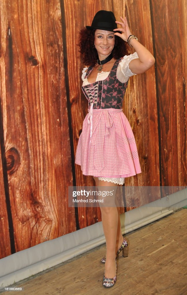 Christina Lugner, wearing traditional Austrian Dirndl costume, poses during the 'Wiener Wirten Tag' as part of Wiener Wiesn Festival 2013 on September 25, 2013 in Vienna, Austria.