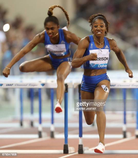 US Christina Manning and Kendra Harrison compete in the women's 100 metres hurdles during the Diamond League athletics competition at the Suhaim bin...