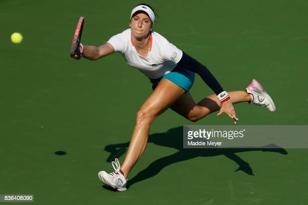 Christina McHale of the United States dives after a shot by Anastasia Pavlyuchenkova of Russia during Day 4 of the Connecticut Open at Connecticut...
