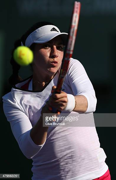 Christina McHale of the United States plays a backhand against Jie Zheng of China during their first round match during day 3 at the Sony Open at...
