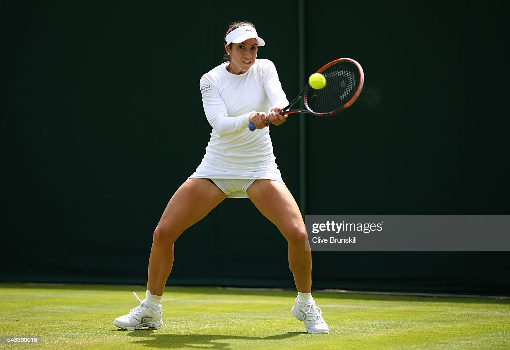 <a gi-track='captionPersonalityLinkClicked' href=/galleries/search?phrase=Christina+McHale&family=editorial&specificpeople=5671165 ng-click='$event.stopPropagation()'>Christina McHale</a> of the United States plays a backhand during the LadiesSingles first round match against Daniela Hantuchova of Slovakia on day two of the Wimbledon Lawn Tennis Championships at the All England Lawn Tennis and Croquet Club on June 28, 2016 in London, England.