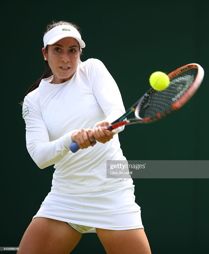 <a gi-track='captionPersonalityLinkClicked' href=/galleries/search?phrase=Christina+McHale&family=editorial&specificpeople=5671165 ng-click='$event.stopPropagation()'>Christina McHale</a> of the United States plays a backhand during the Ladies Singles first round match against Daniela Hantuchova of Slovakia on day two of the Wimbledon Lawn Tennis Championships at the All England Lawn Tennis and Croquet Club on June 28, 2016 in London, England.