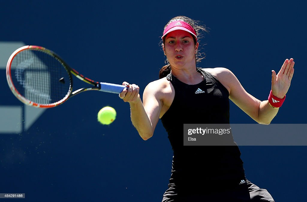 <a gi-track='captionPersonalityLinkClicked' href=/galleries/search?phrase=Christina+McHale&family=editorial&specificpeople=5671165 ng-click='$event.stopPropagation()'>Christina McHale</a> of the United States returns a shot against Victoria Azarenka of Belarus during their women's singles second round match on Day Four of the 2014 US Open at the USTA Billie Jean King National Tennis Center on August 28, 2014 in the Flushing neighborhood of the Queens borough of New York City.