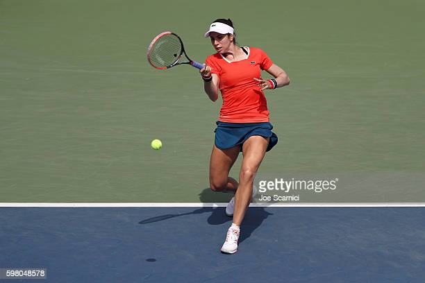 Christina McHale of the United States returns a shot to Roberta Vinci of Italy during her second round Women's Singles match on Day Three of the 2016...