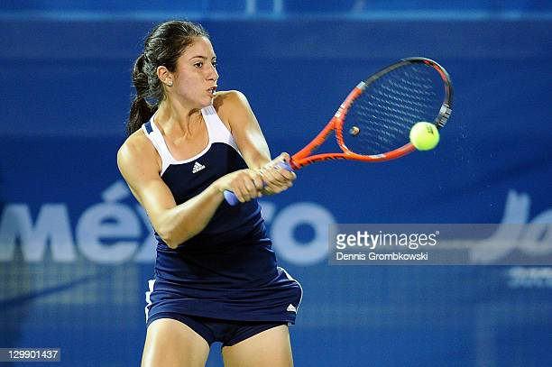 Christina McHale of the United States returns the ball to Florencia Molinero and Maria Irigoyen of Argentina during the women's doubles final on Day...