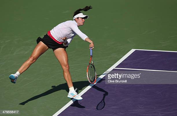 Christina McHale of the United States serves against Jie Zheng of China during their first round match during day 3 at the Sony Open at Crandon Park...