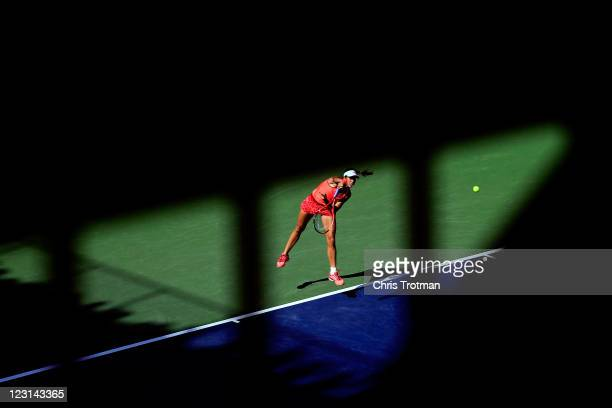Christina McHale of the United States serves against Marion Bartoli of France during Day Three of the 2011 US Open at the USTA Billie Jean King...