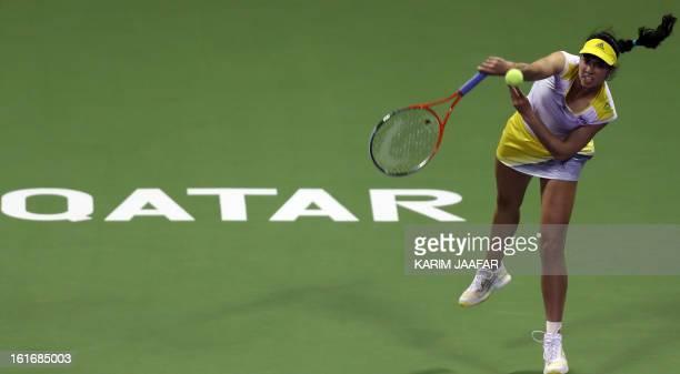 Christina Mchale of US returns the ball to Victoria Azarenka of Belarus during their WTA Qatar Open tennis match on February 14 2013 in the Qatari...