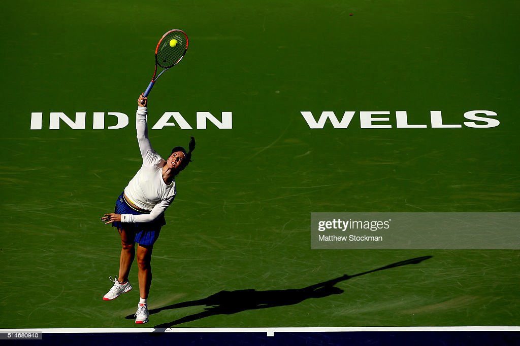 <a gi-track='captionPersonalityLinkClicked' href=/galleries/search?phrase=Christina+McHale&family=editorial&specificpeople=5671165 ng-click='$event.stopPropagation()'>Christina McHale</a> serves to Caroline Garcia of France during the BNP Paribas Open at the Indian Wells Tennis Garden on March 10, 2016 in Indian Wells, California.