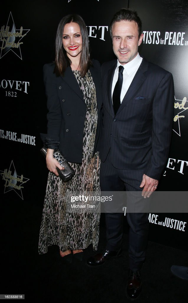 Christina McLarty (L) and David Arquette arrive at the 6th Annual Hollywood Domino Pre-Oscar Gala & Tournament held at Sunset Tower on February 21, 2013 in West Hollywood, California.