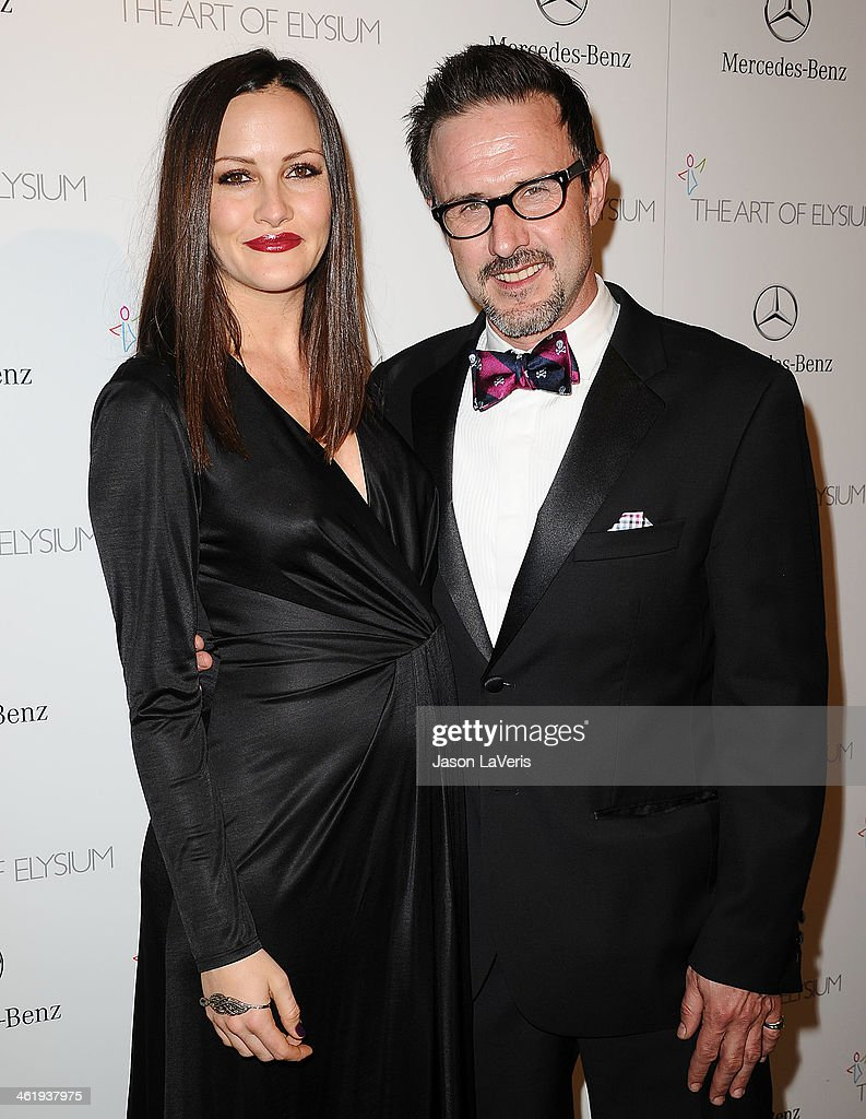 Christina McLarty and David Arquette attend the Art of Elysium's 7th annual Heavan gala at Skirball Cultural Center on January 11 2014 in Los Angeles...