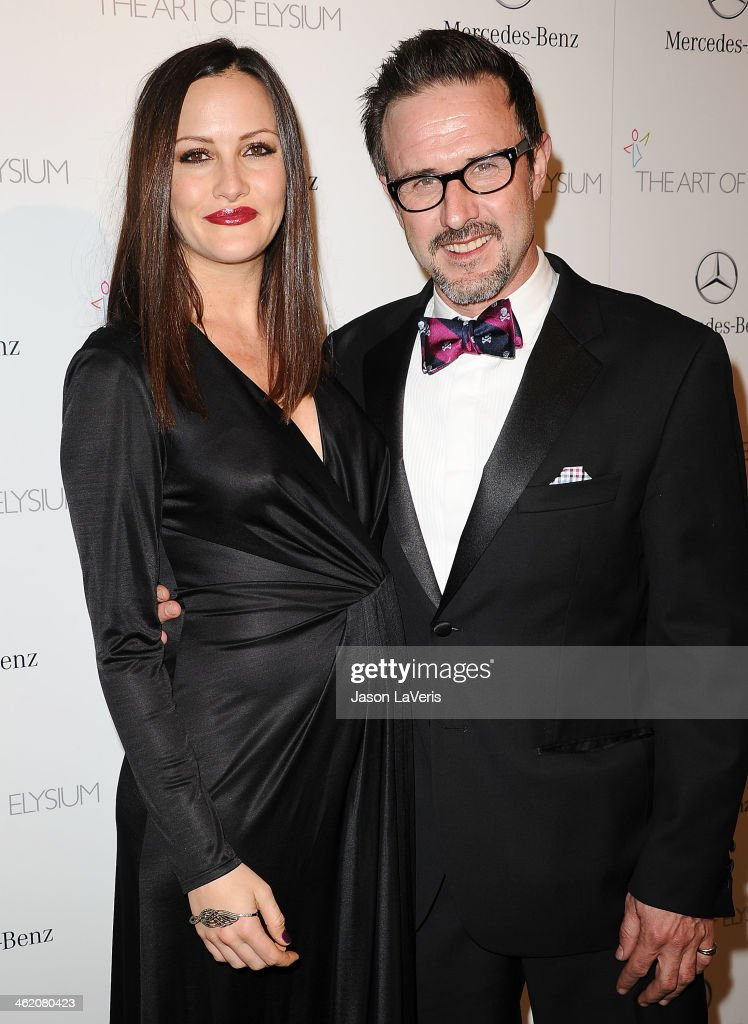 Christina McLarty and David Arquette attend the Art of Elysium's 7th annual Heavan gala at Skirball Cultural Center on January 11, 2014 in Los Angeles, California.