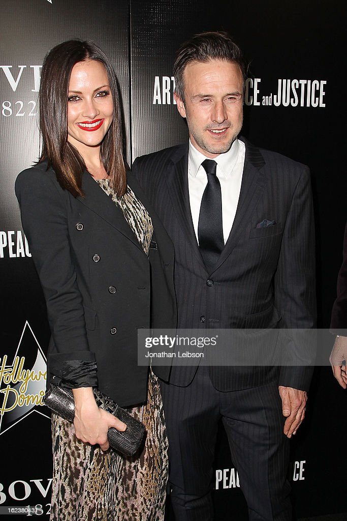 Christina McLarty and David Arquette attend the Hollywood Domino And Bovet 1822 Gala Benefiting Artists For Peace And Justice at Sunset Tower on February 21, 2013 in West Hollywood, California.