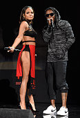 Christina Milian and Lil Wayne perform onstage at the 2014 American Music Awards at Nokia Theatre LA Live on November 23 2014 in Los Angeles...