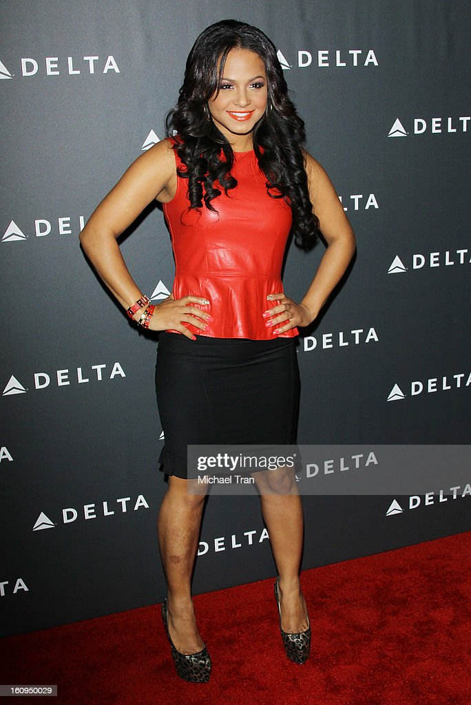 <a gi-track='captionPersonalityLinkClicked' href=/galleries/search?phrase=Christina+Milian&family=editorial&specificpeople=171274 ng-click='$event.stopPropagation()'>Christina Milian</a> arrives at Delta Air Lines celebrates the GRAMMY Awards held at The Getty House on February 7, 2013 in Los Angeles, California.