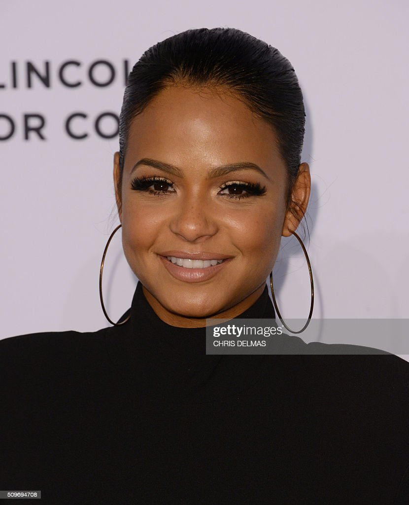 Christina Milian arrives at the 7th Annual Black Women In Music Concert, an Essence Kicks Off Grammy Week-end event, in Hollywood, California, February 11, 2016 / AFP / CHRIS DELMAS