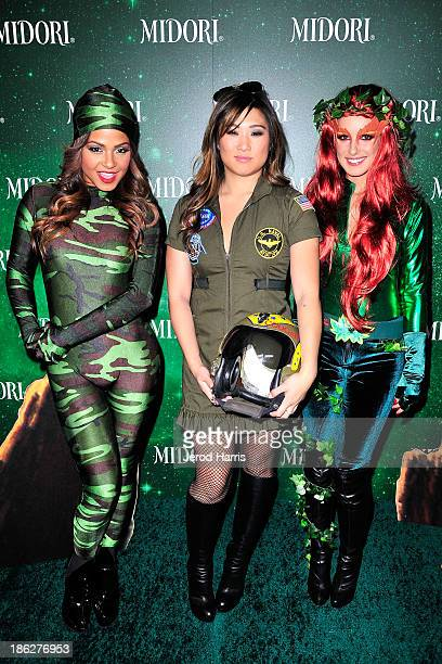 Christina Milian Jenna Ushkowitz and Shenae Grimes arrive at the 3rd Annual Midori Green Halloween at Bootsy Bellows on October 29 2013 in West...