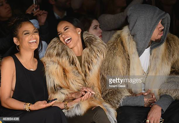 Christina Milian Karrueche Tran and Chris Brown attend the Michael Costello fashion show during MercedesBenz Fashion Week Fall 2015 at The Salon at...