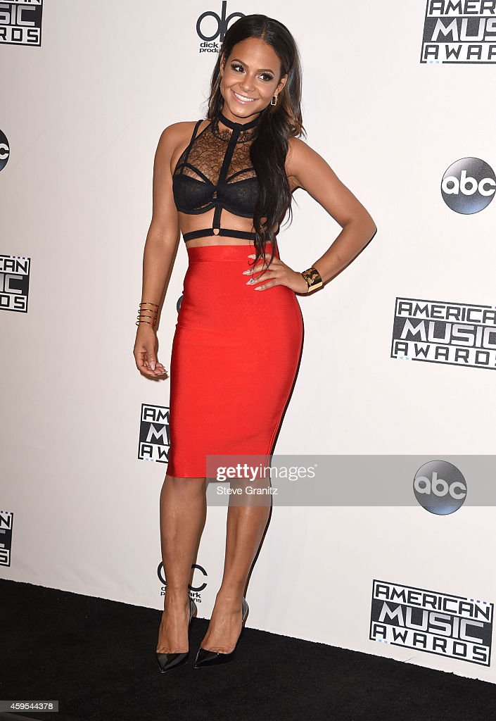 Christina Milian poses in the 2014 American Music Awards Press Room at Nokia Theatre LA Live on November 23 2014 in Los Angeles California