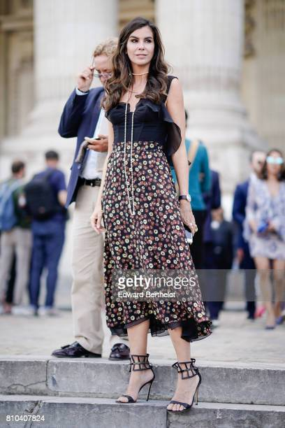 Christina Pitanguy wears a floer print dress black heels shoes outside the Ralph Russo show during Paris Fashion Week Haute Couture Fall/Winter...
