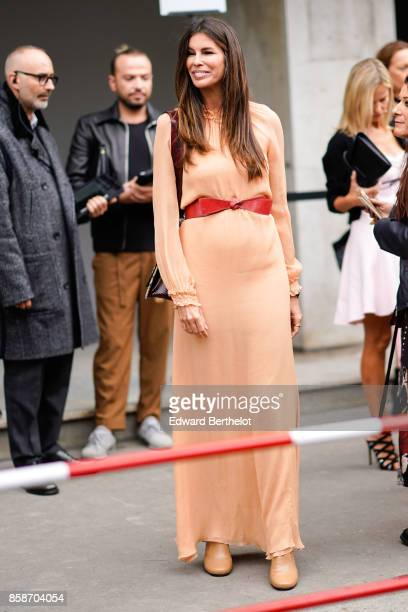 Christina Pitanguy wears a pink dress a red belt outside Giambattista Valli during Paris Fashion Week Womenswear Spring/Summer 2018 on October 2 2017...
